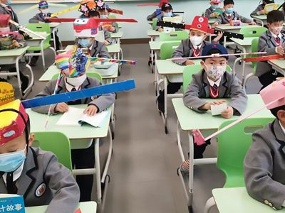 social-distancing-hats-first-graders